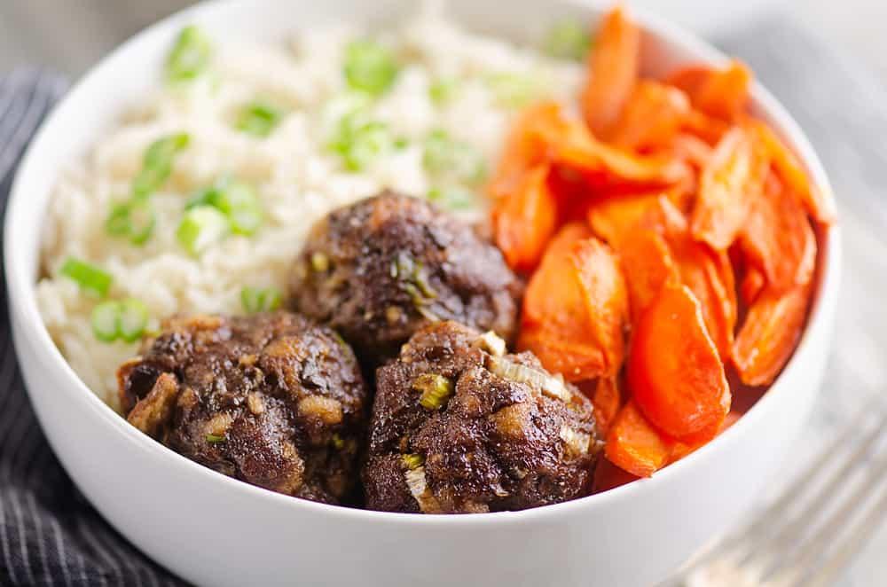 Glazed Hoisin Meatballs, carrots and rice in white bowl