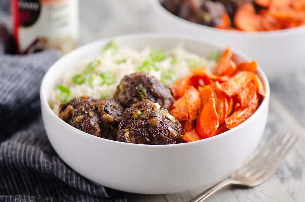 Glazed Hoisin Meatball Bowls served on table with fork