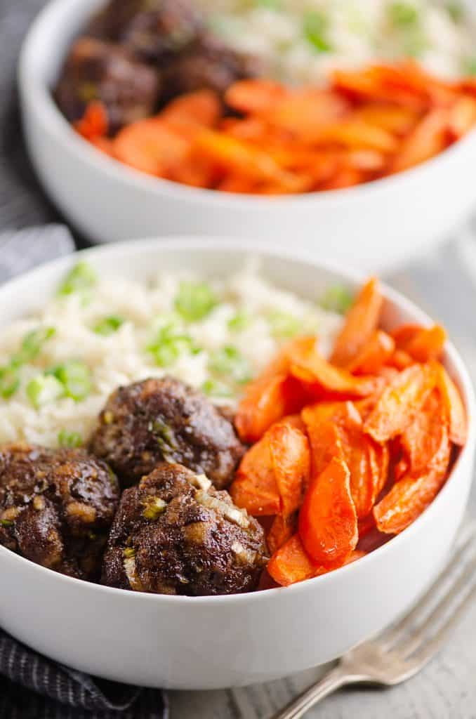 Glazed Hoisin Meatball Bowls served on countertop with fork