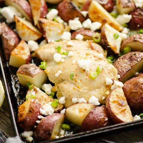 Lemon Feta Sheet Pan Chicken Thighs & Potatoes with yogurt sauce