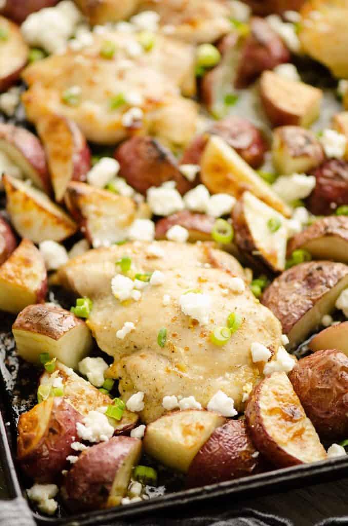 Lemon Feta Sheet Pan Chicken Thighs & Potatoes on pan