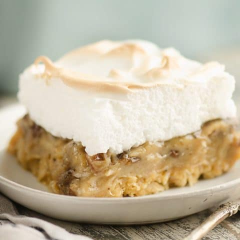 Sour Cream Raisin Meringue Bars served on table with fork