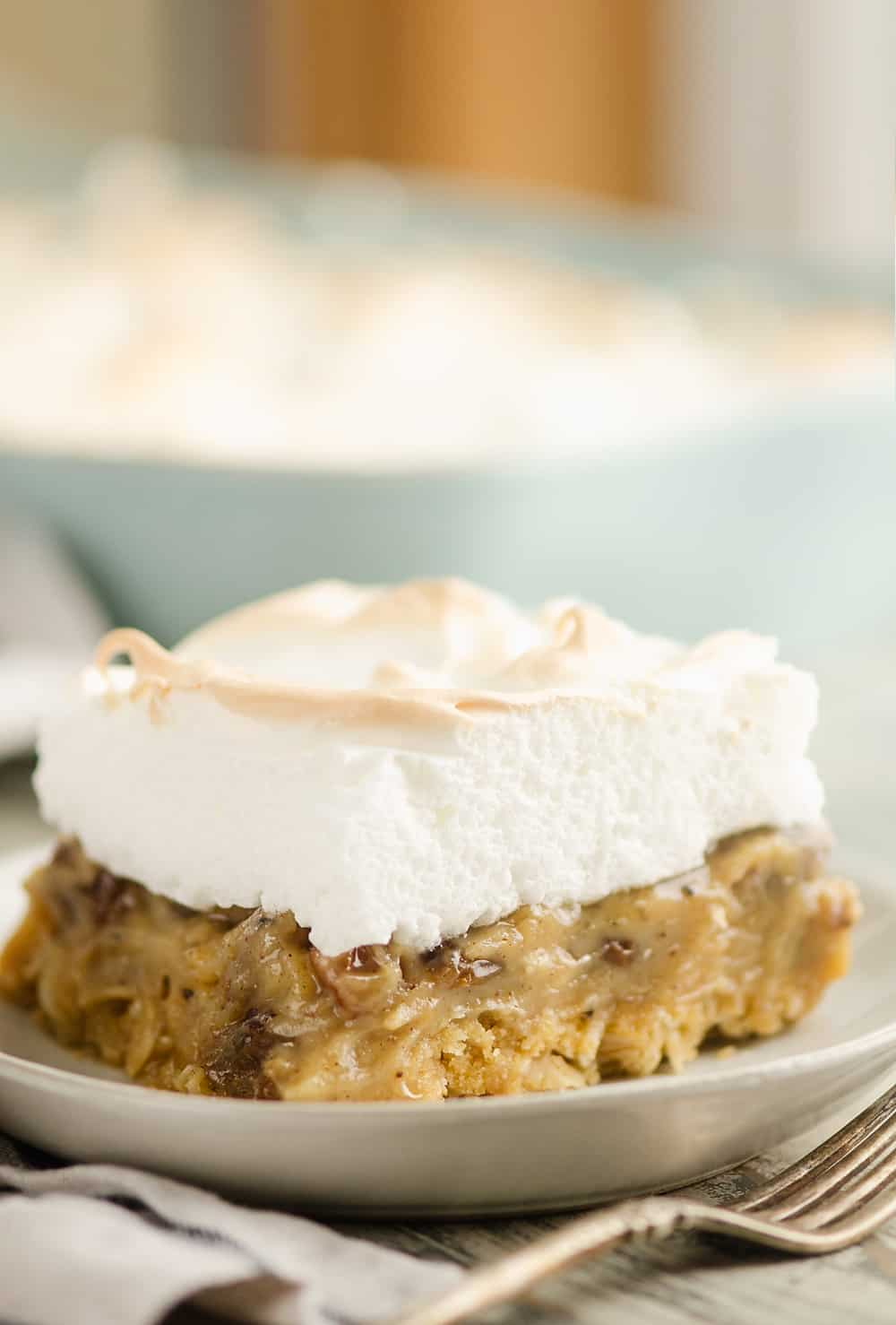 Sour Cream Raisin Meringue Bars on plate