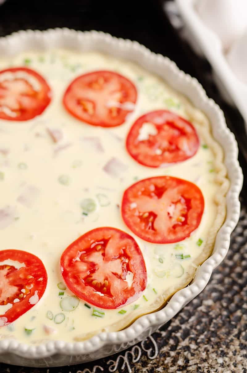 Ham and Goat Cheese Quiche topped with tomatoes