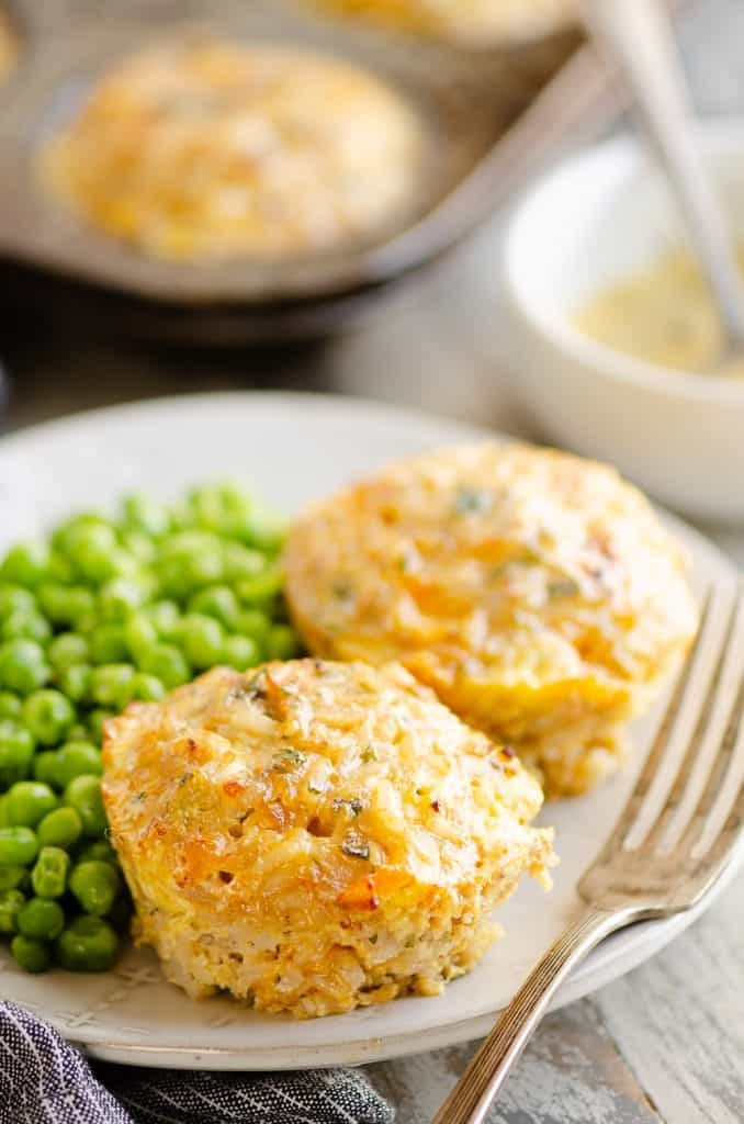 Buttery Tuna Rice Muffins served on plate with green peas