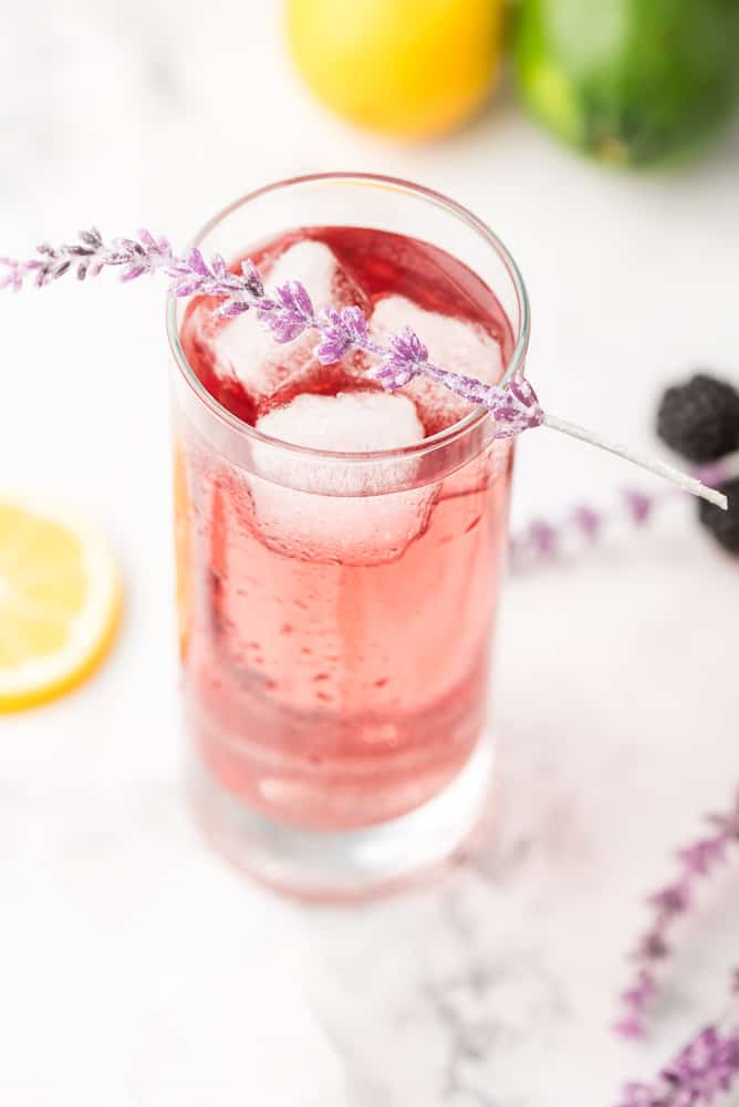 Purple Rain Cocktail topped with sprig of lavendar