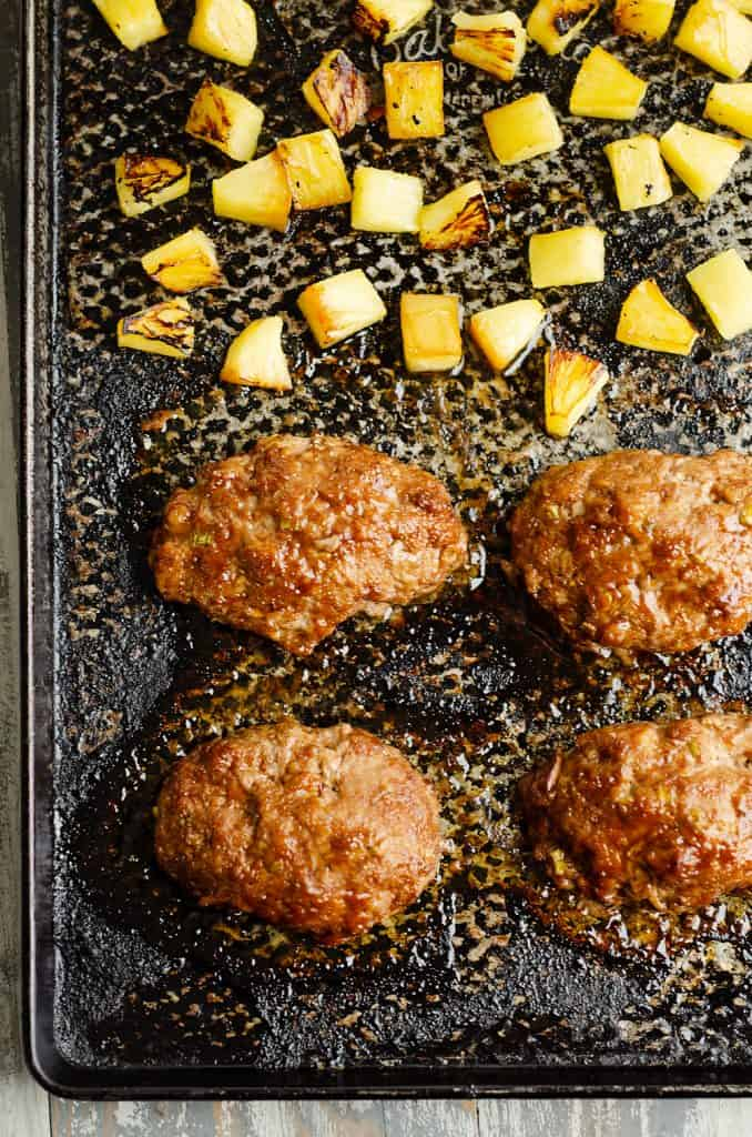Roasted Pineapple and mini meatloaves on sheet pan