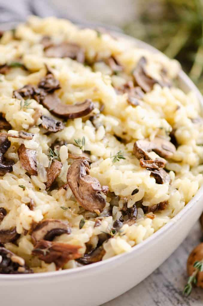 Pressure Cooker Mushroom Risotto in bowl with mushrooms and thyme