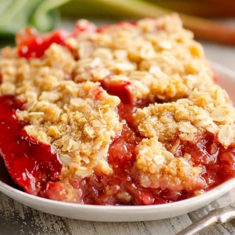 Strawberry Rhubarb Crisp Bars on white plate with fork