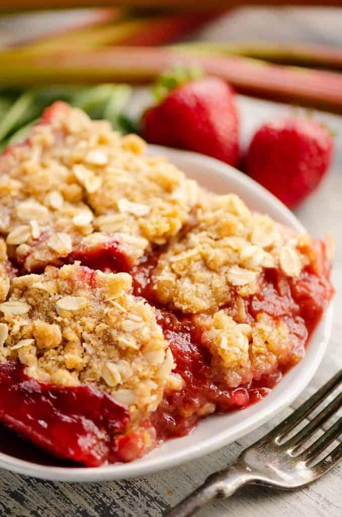Strawberry Rhubarb Crisp Bars on white plate