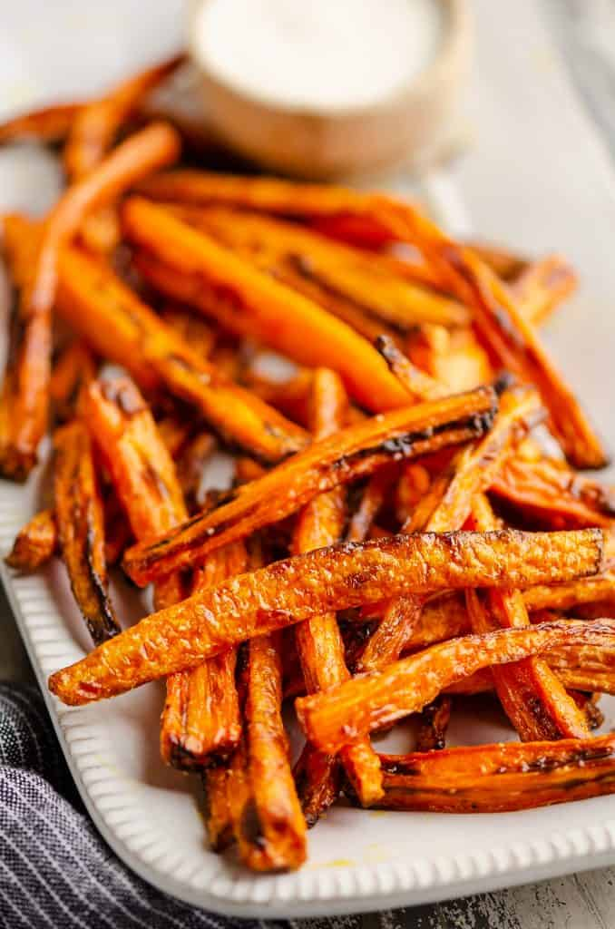 Crispy Carrot Fries on white platter served with ranch