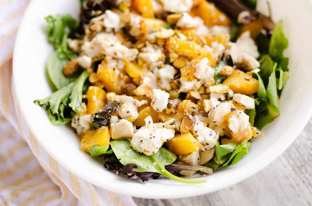 Chicken Peach Salad in a white bowl