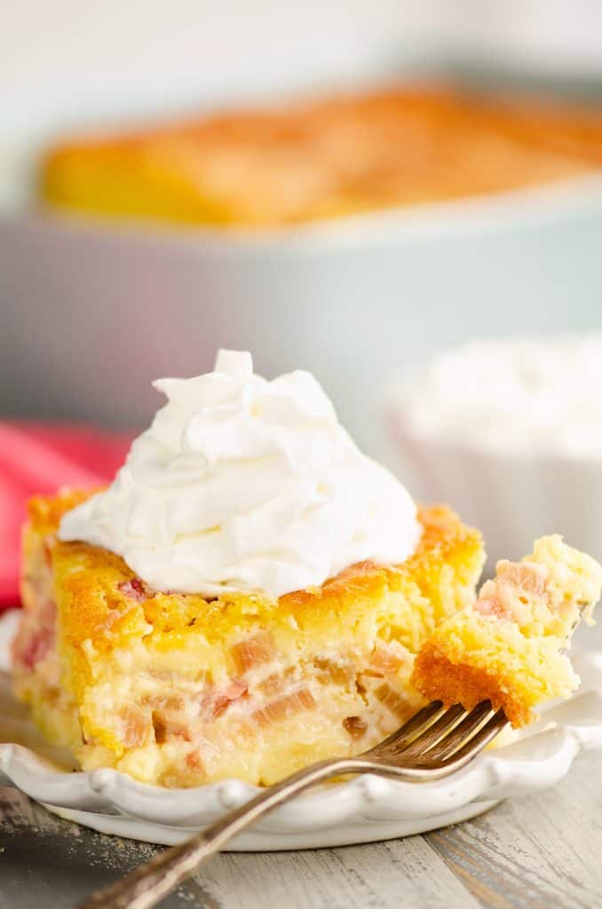 Rhubarb Custard Cake on plate with a bite on fork