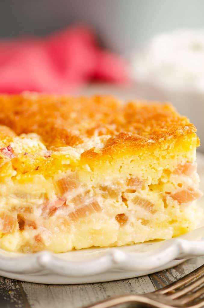 Rhubarb Custard Cake on white plate with fork