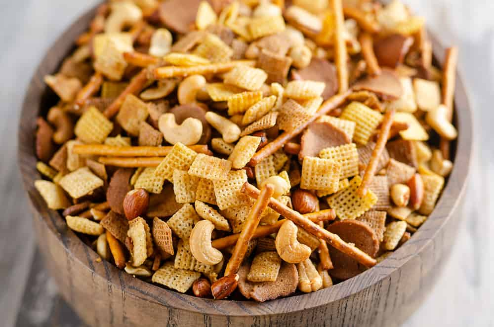 Buttery snack mix in large wooden bowl