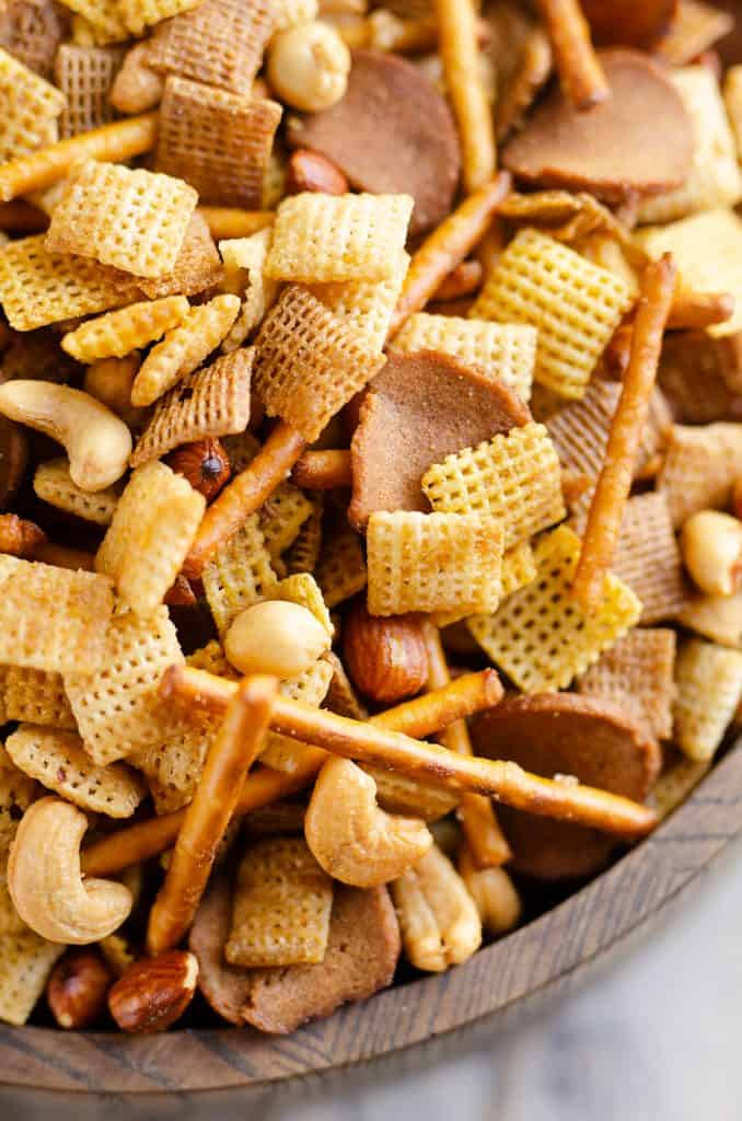buttery snack mix in bowl with Chex Mix, nuts, pretzels and rye chips
