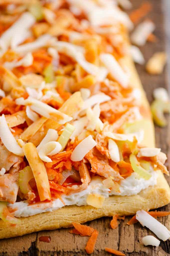 Buffalo Chicken Vegetable Pizza on wooden table