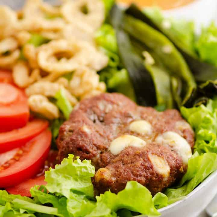 Smoked Cheese Curd Burger Salad on table with chipotle dressing