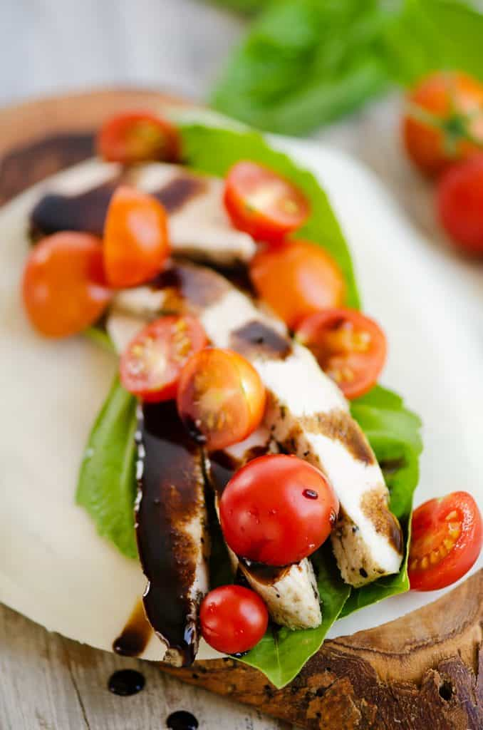 balsamic chicken, tomatoes and basil layered on mozzarella cheese wrap