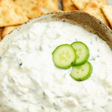 Cucumber Feta Greek Yogurt Dip topped with small slices of cucumber
