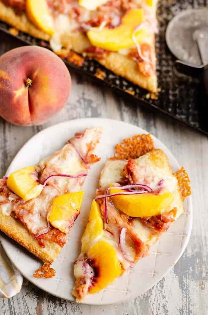 slice of BBQ Peach Pizza on white plate