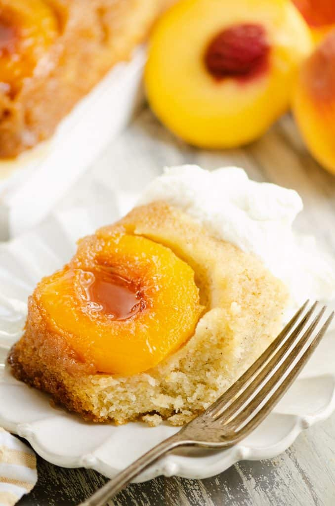 Peach Upside Down Cake on white plate with fork