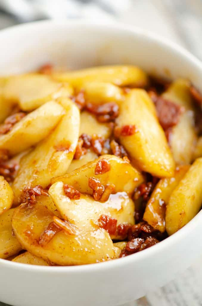 Caramelized Bacon & Apples in white bowl on table