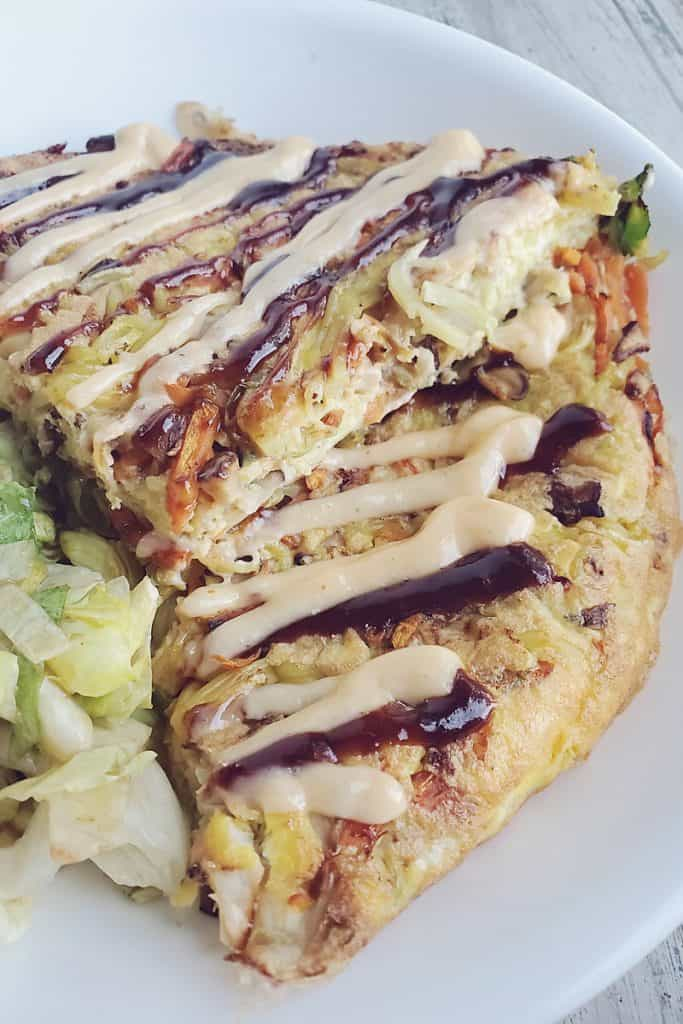 Gobble Japanese Okonomiyaki Yakisoba Noodle Omlette topped with sriracha mayo on plate