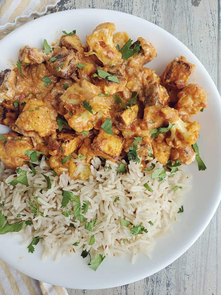 Gobble Paneer Cauliflower Tikka Masala and rice on white plate