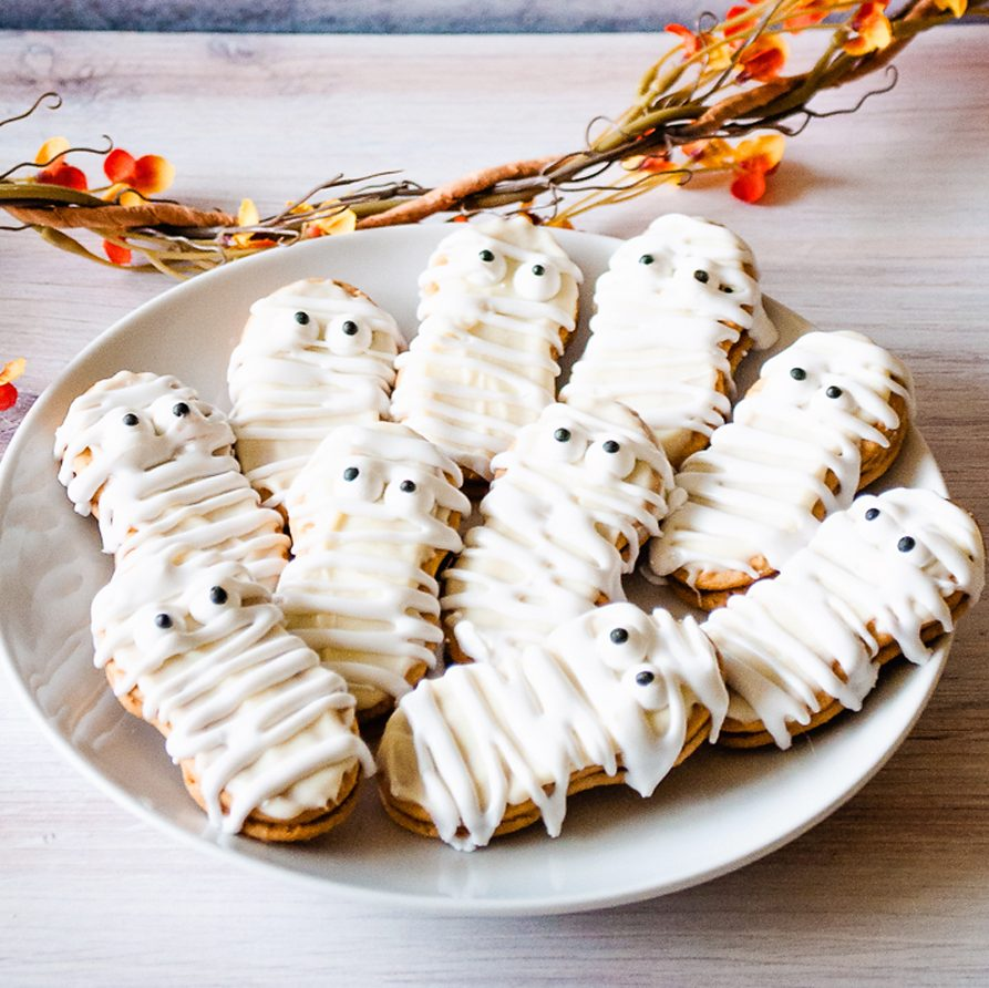 Mummy Nutter Butter Cookies on table with garland