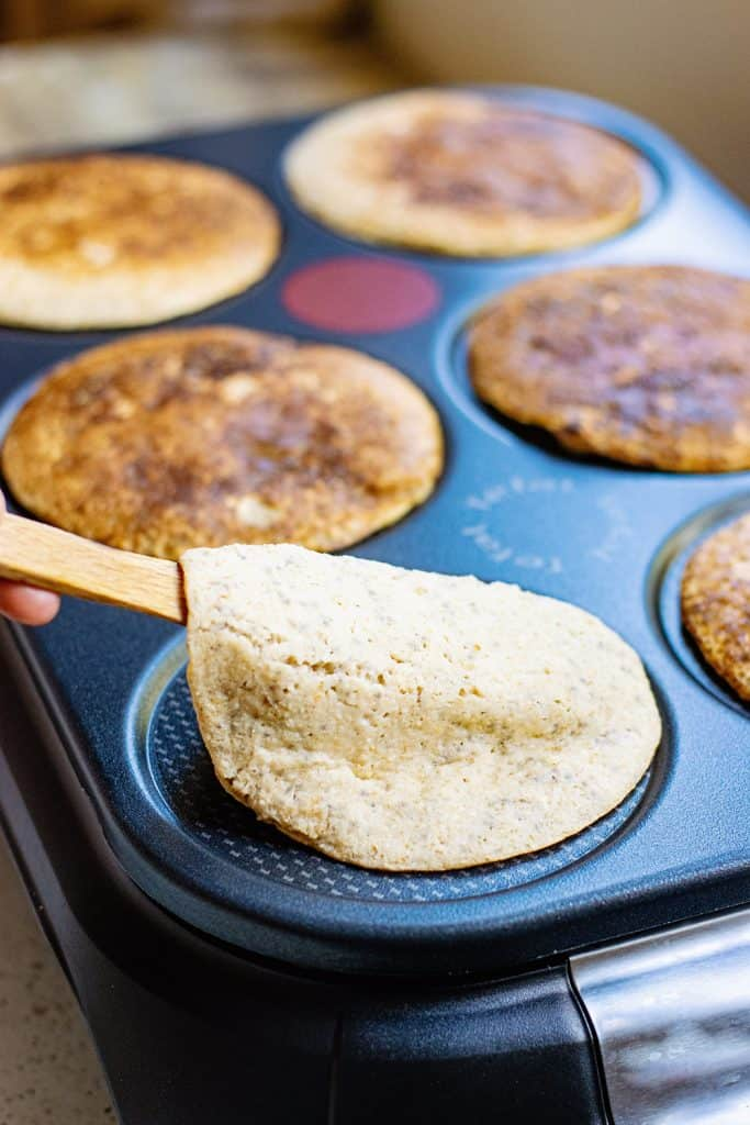 flipping Oatmeal Pancakes on griddle