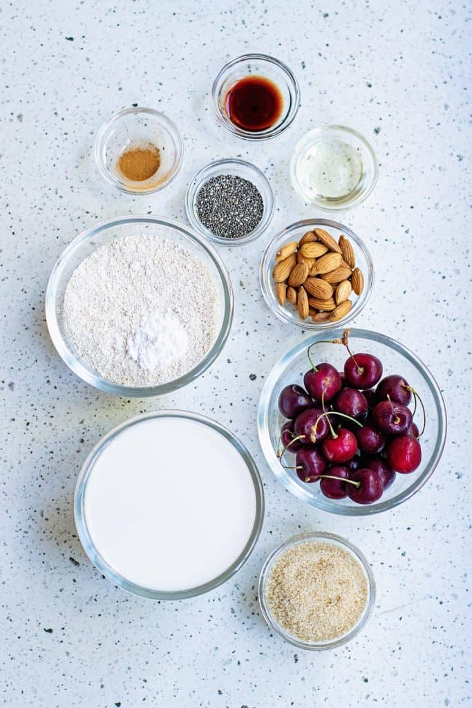 Oatmeal Pancakes ingredients in bowls on table
