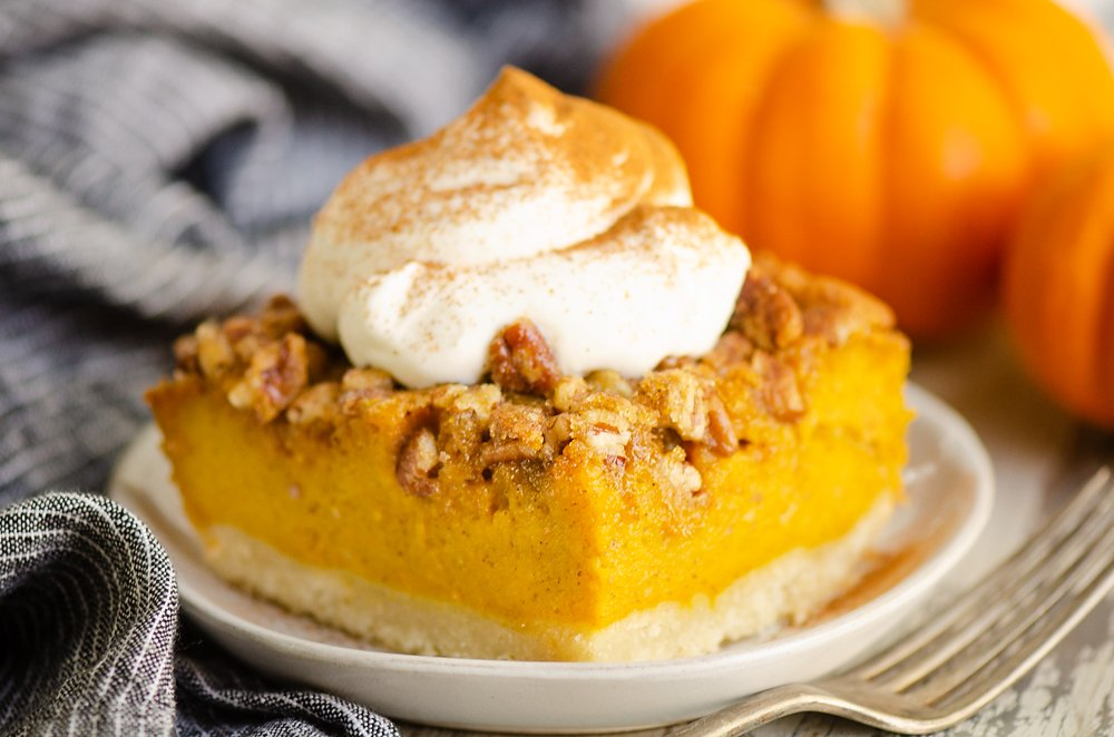 Pumpkin Pecan Custard Pie Bars on plate with whipped cream