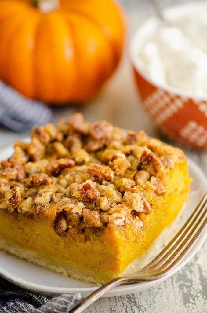 Pumpkin Pecan Custard Pie Bar on plate with fork