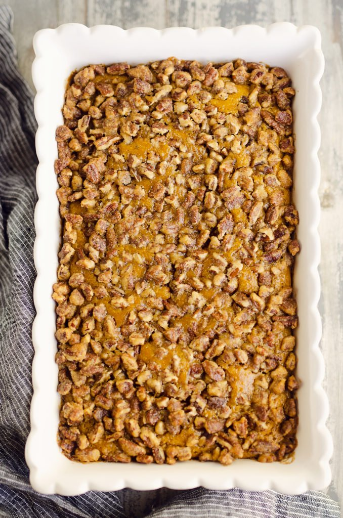 Pumpkin Pecan Custard Pie Bars in scalloped white pan