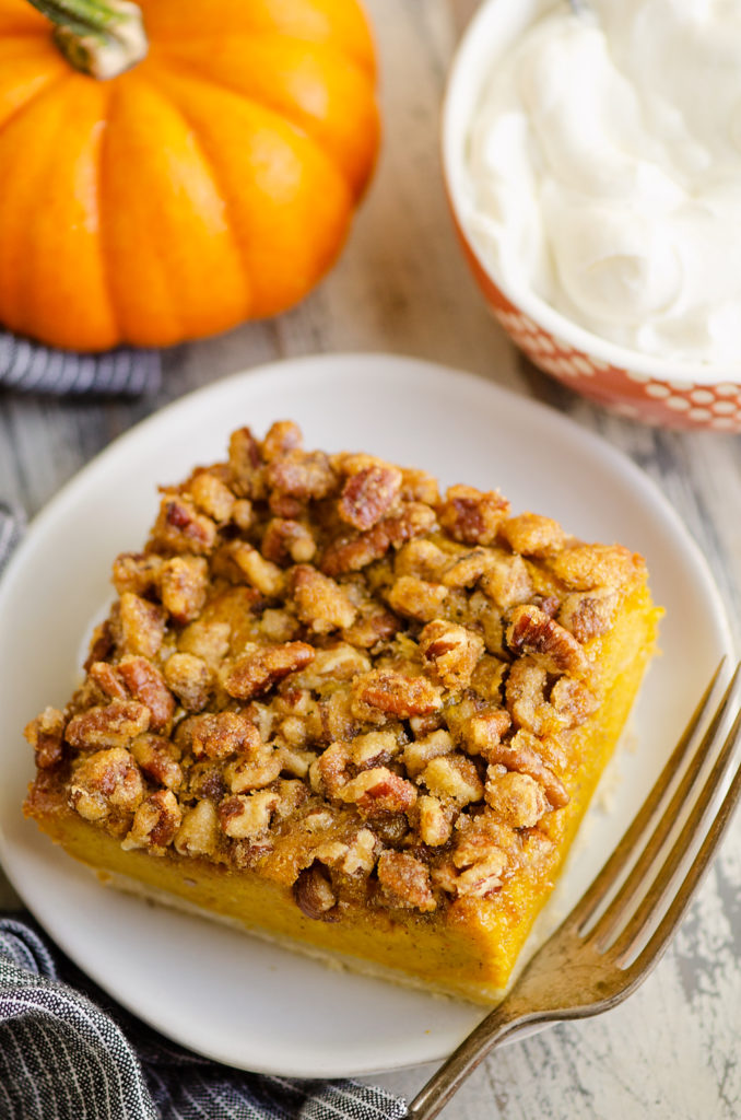 Pumpkin Pecan Custard Pie Bars on white plate with fork