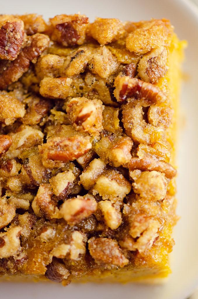 Pumpkin Pecan Custard Pie Bars topped with cinnamon pecans
