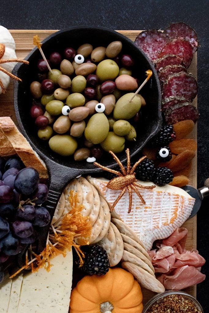 Spooky eyeball olives on Halloween Charcuterie Board