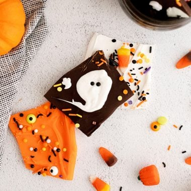 Halloween Ghost and orange chocolate bark on white table with sprinkles