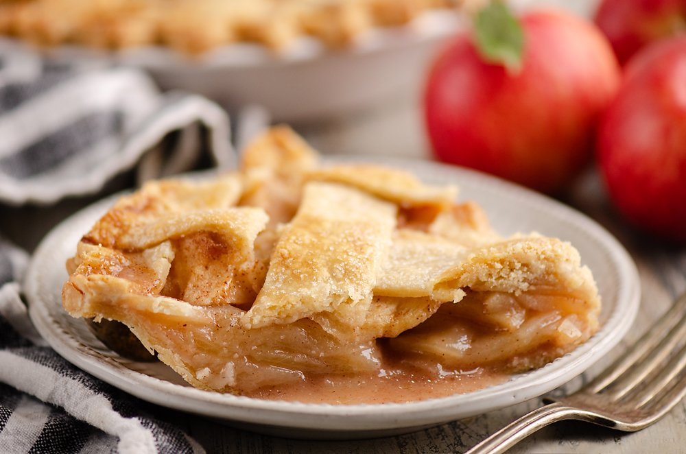 Old Fashioned Apple Pie slice on white plate with napkin