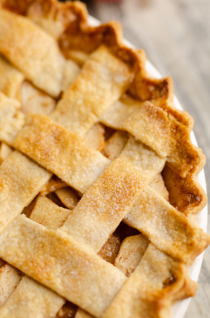 Old Fashioned Apple Pie with lattice crust in white pie plate