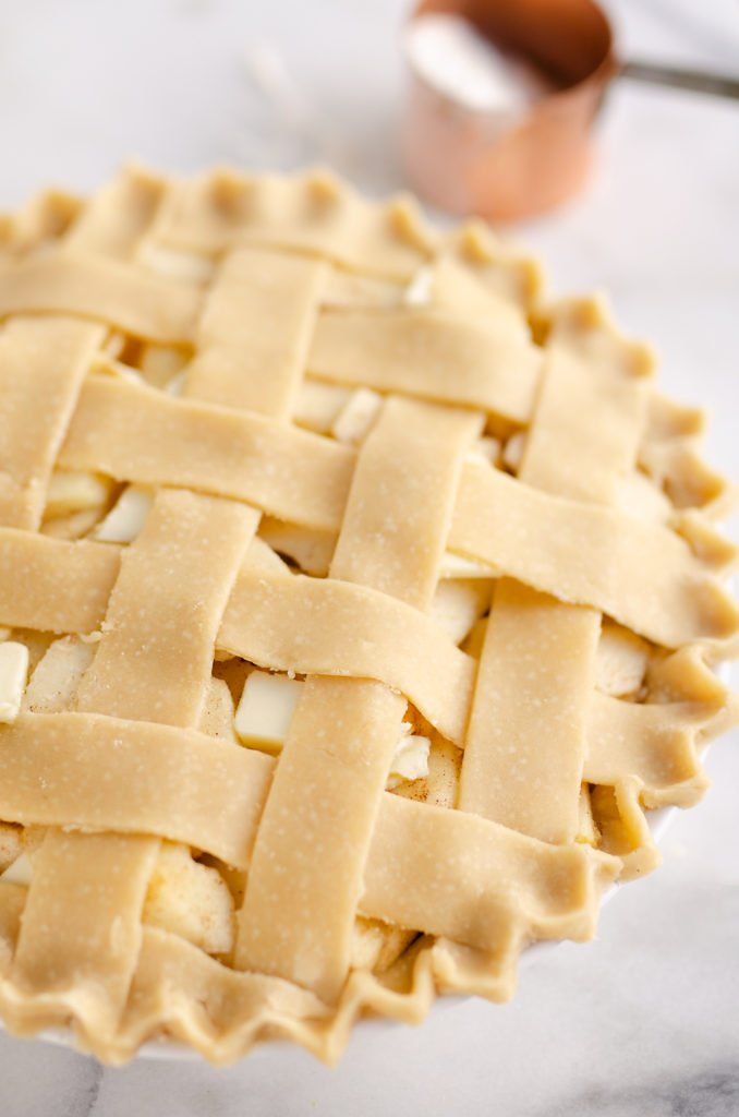 Old Fashioned Apple Pie on marble table with lattice crust