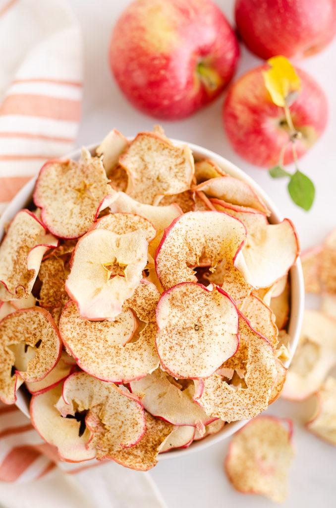 baked apple chips in white bowl