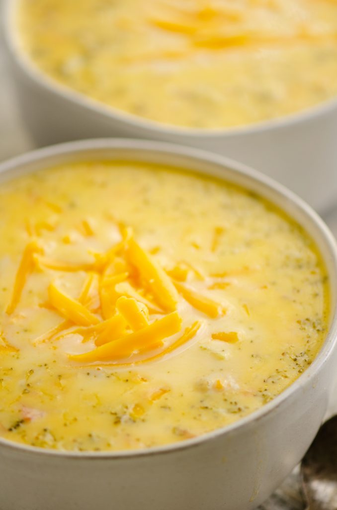 Pressure Cooker Cheesy Ham & Broccoli Soup in white bowl with spoon