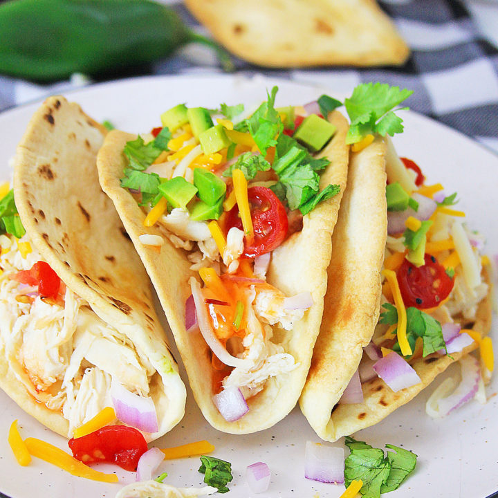 Pressure Cooker Chili Lime Chicken Tacos on white plate