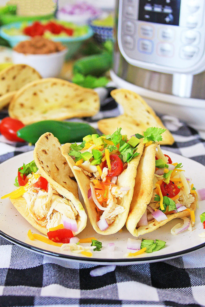 Pressure Cooker Chili Lime Chicken Tacos on table with Instant Pot