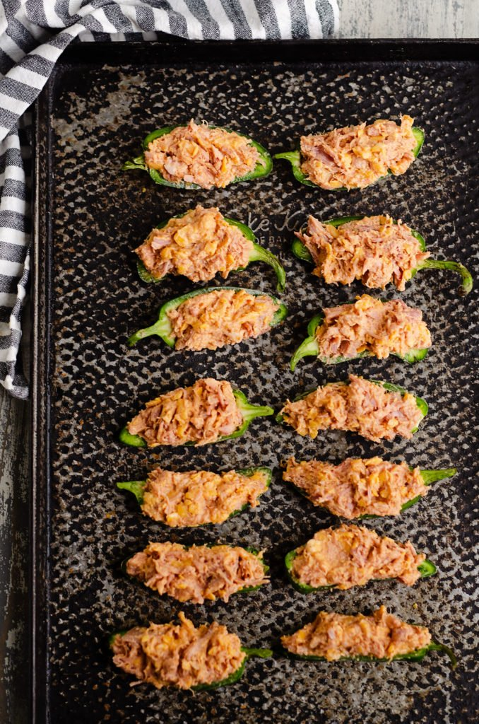 Cheesy BBQ Pork Jalapeno Poppers on black sheet pan