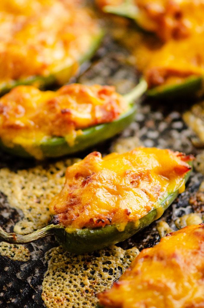 Cheesy BBQ Pork Jalapeno Poppers baked with cheese on sheet pan