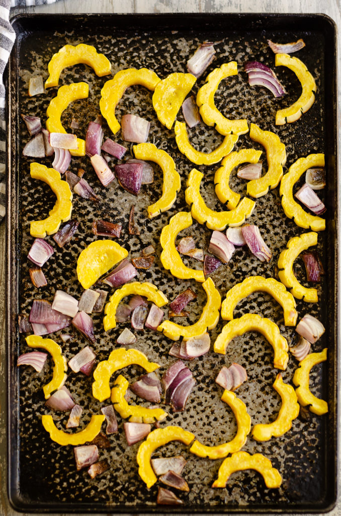 Roasted Delicata Squash and onions on sheet pan