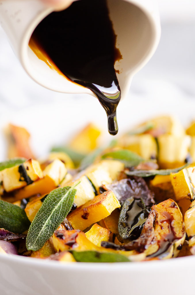 Crispy Sage Roasted Delicata Squash drizzled with balsamic glaze